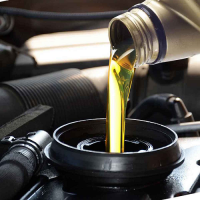 motor oil being poured into engine